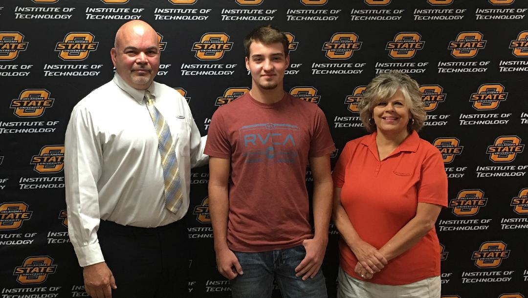 Student Timothy Sanders signed his sponsorship with Flex-N-Gate to attend OSUIT.