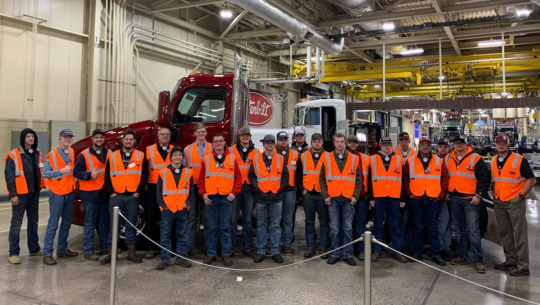 19 Truck Technician program students visiting the Peterbilt truck building facility in Denton, TX.