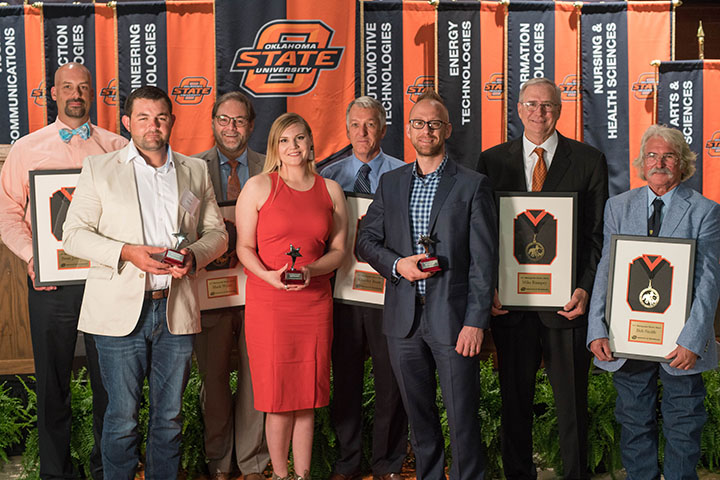 2017 Alumni Hall of Fame inductees Scott Johnson, left, Dylan Ingram, Mark Wyatt, Kyndl Rowland, Charley Been, Brandon Harn, Mike Rampey, and Bob Smith