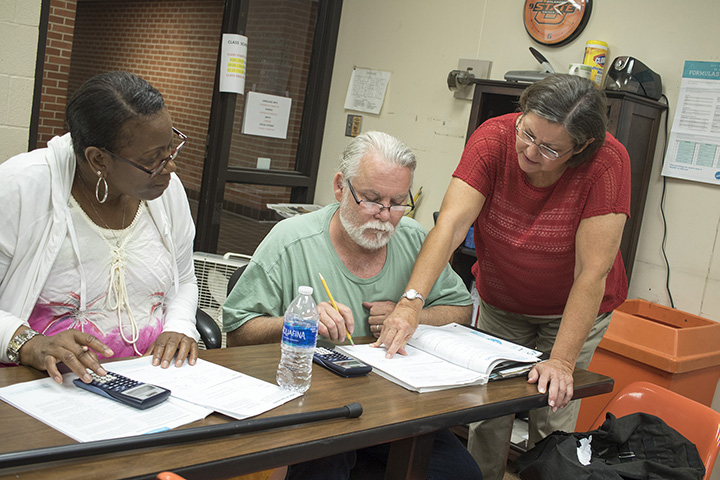 Fran Colombin, coordinator of OSUIT's Adult Basic Education program, works with students working toward their GED.