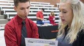 Student visits with potential employer at career fair