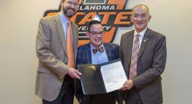 Dr. Scott Newman, OSUIT vice president of Academic Affairs; Gene Leiterman, dean of the School of Culinary Arts; and Dr. Ben Goh, assistant dean of the College of Human Sciences and director of the School of Hospitality and Tourism Management at OSU Stillwater, stand with the signed articulation agreement between the two schools.