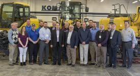 Representatives from OSUIT and the Komatsu ACT advisory board stand in front of two new engines that were donated to OSUIT's Komatsu ACT program.
