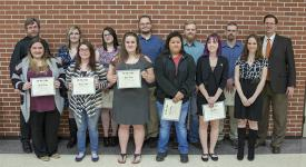 Ten of the newest inductees into OSUIT's chapter of Phi Theta Kappa Honor Society stands with advisors Michael Hass and Rebekah Boudreaux and President Bill R. Path.