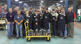 Pipeline Integrity students as well as technicians from Balon Valves manufacturing plant stand with their completed valves made by the students during a recent trip to the plant.