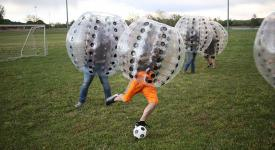 Students play Knockerball on the Sports Field.