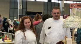 Culinary students Casey Newell, right, and Gage Simpson look at cake entries in the Oklahoma Sugar Art Show.